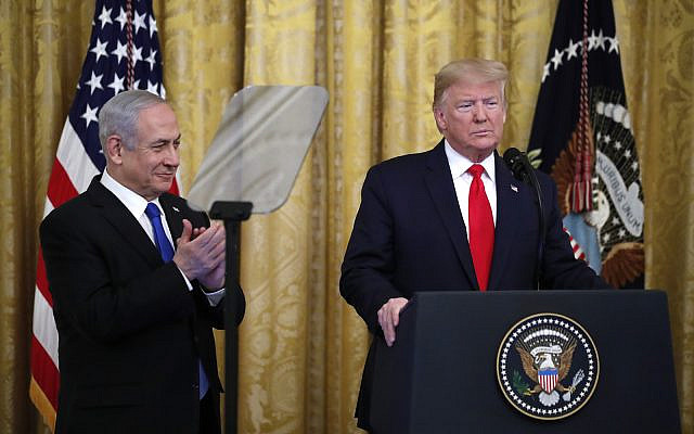 President Donald Trump pauses as he announces a deal for Israeli-Palestinian peace with Prime Minister Benjamin Netanyahu in the East Room of the White House, January 28, 2020, in Washington. (AP Photo/Alex Brandon)