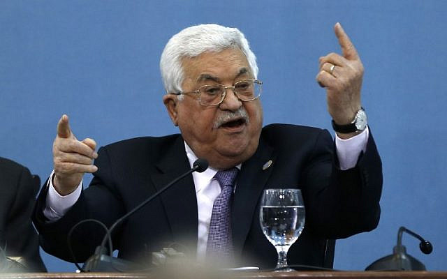Palestinian president Mahmoud Abbas speaks at the Palestinian Peace and Freedom Forum, which was created by the Palestine Liberation Organisation's (PLO) Committee for Interaction with Israeli Society, in Ramallah in the West Bank on February 6, 2019, with the attendance of Israeli activists. (Photo by ABBAS MOMANI / AFP)