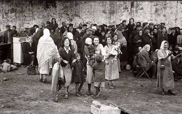 The Jews of Jasionowska are rounded up in front of the church, 27 January 1943