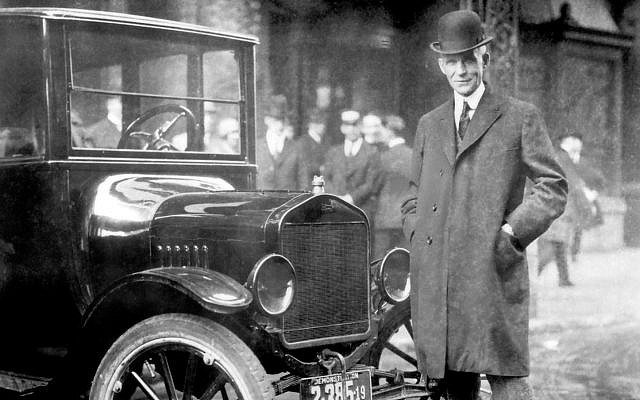 Henry Ford, with 1921 Model T. Ford was at the forefront of spreading the false rumors of a Jewish conspiracy. (Ford Motor Company/Wikimedia)