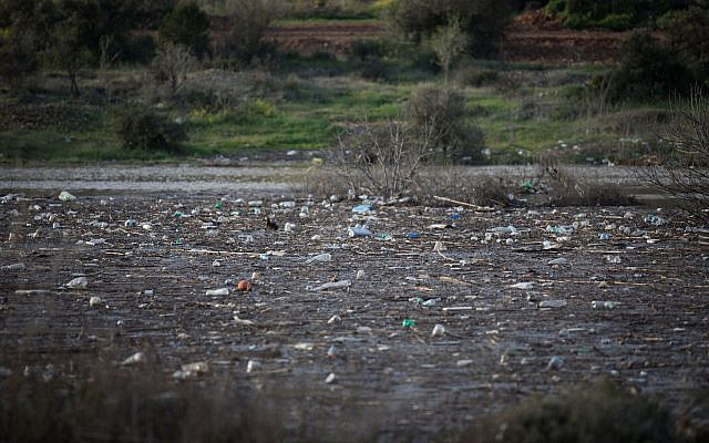 Illustrative. Plastic bottles and other trash in the Beit Zait water reservoir near Jerusalem, on March 1, 2019. (Hadas Parush/Flash90)