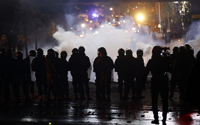 Lebanese riot police fire tear gas towards supporters of the Shiite Hezbollah and Amal groups in Beirut, Lebanon, December 17, 2019. (Bilal Hussein/AP)