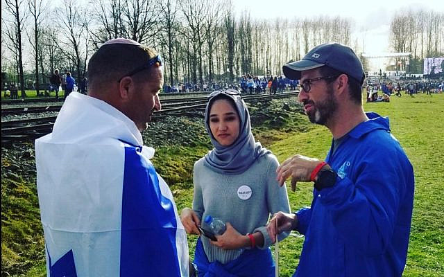 Tuvia talking with a Muslim student and her Catholic teacher from an Austrian high school at Birkenau. Photo (c) T. Book, 2020