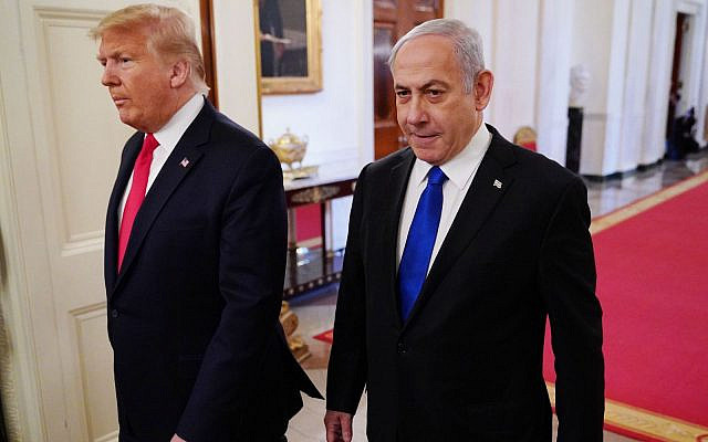 US President Donald Trump and Israeli Prime Minister Benjamin Netanyahu arrive for an announcement of Trump's Middle East peace plan in the East Room of the White House in Washington, DC on January 28, 2020. (Photo by MANDEL NGAN / AFP) (Photo by MANDEL NGAN/AFP via Getty Images)
