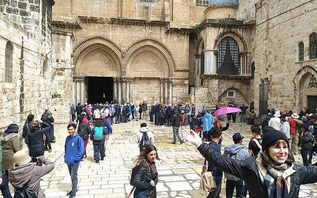 Tourists gather at the Church of the Holy Sepulchre in the Old City of Jerusalem