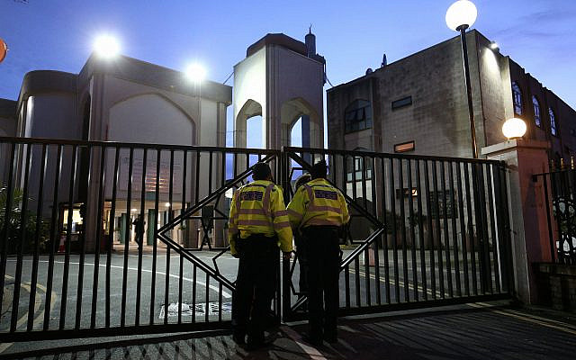 Police officers outside the main entrance to the London Central Mosque near Regent's Park, North London, after morning prayers (Photo credit: Jonathan Brady/PA Wire via Jewish News)