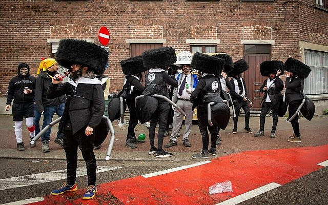 People dressed as ultra-Orthodox Jews/ants are seen before the start of the Aalst Carnival's on February 23, 2020, in Aalst, Belgium. (James Arthur Gekiere/AFP)