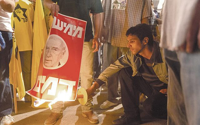 Dramatization from Incitement - Amir torches anti-Rabin Poster at 1995 Protest Rally