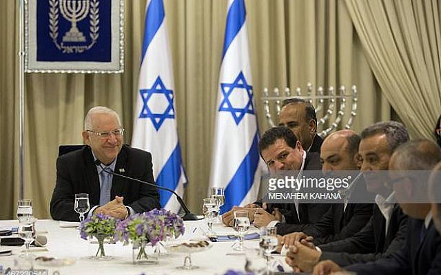 Israeli President Reuven Rivlin (L) listens to Ayman Odeh (4th-R), head of the Joint List, an alliance of four small Arab-backed parties, during consultations at the President's residence in Jerusalem on March 22, 2015, to hear who they would recommend as prime minister. In Israel, it is not necessarily the leader of the largest party who forms the next government and becomes the premier, but the one who can form a working coalition, preferably with a majority of at least 61 -- in this case, Netanyahu. AFP PHOTO/MENAHEM KAHANA        (Photo credit should read MENAHEM KAHANA/AFP via Getty Images)