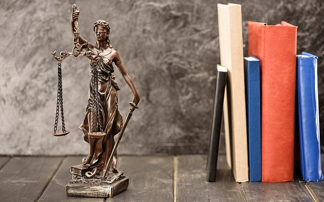 Illustrative. Lady Justice and the books of law. (iStock)