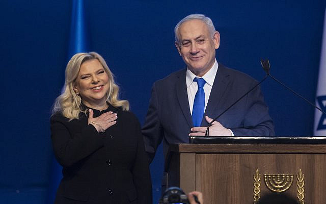 Israeli Prime Minister Benjamin Netanyahu and wife Sara thank Likud supporters at a Tel Aviv celebration of the party's election victory, March 3, 2020. (Amir Levy/Getty Images)