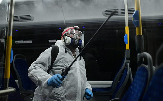 Workers wearing protective suits disinfect a bus as a preventive measure amid fears over the spread of the coronavirus, in Tel Aviv Photo by: Tomer Neuberg-JINIPIX via Jewish News