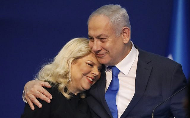 Israeli Prime Minister Benjamin Netanyahu hugs his wife Sara after first exit poll results for the Israeli elections at his party's headquarters in Tel Aviv, Israel, Monday, Feb. 2, 2020. (AP Photo/Ariel Schalit via Jewish News)