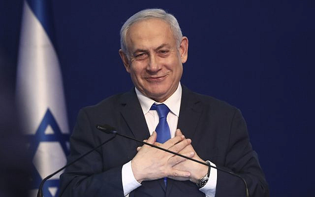 Israeli Prime Minister Benjamin Netanyahu addresses his supporters after first exit poll results for Israeli elections in Tel Aviv, Israel, Monday, March 2, 2020. (AP Photo/Oded Balilty via Jewish News)