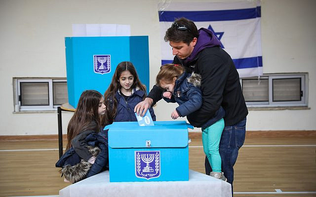 People cast their ballot at a voting station in Jerusalem, during the Knesset Elections, on March 2, 2020. Photo by Olivier Fitoussi/Flash90