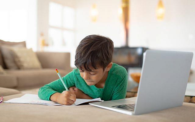 Illustrative. A boy's studies via laptop. (iStock)