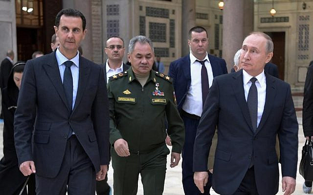 Putin, Assad and Russian defense minister Shoigu, during Putin's last visit to Damascus (Jan 7, 2020) (ALEXEI NIKOLSKY / SPUTNIK, KREMLIN POOL PHOTO VIA AP)