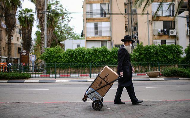 A man walks in Bnei Brak. April 01, 2020. (Tomer Neuberg/Flash90)