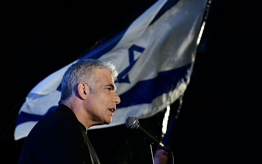 Yair Lapid speaks at a protest against Prime Minister Benjamin Netanyahu calling on him to quit, at Rabin Square, Tel Aviv, April 19, 2020. (Tomer Neuberg/Flash90)