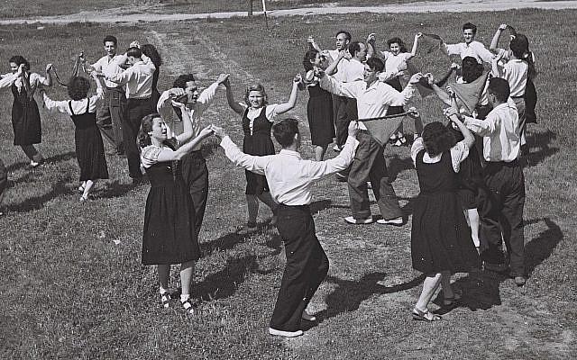 Kibbutznikim joyously dancing in Israel.