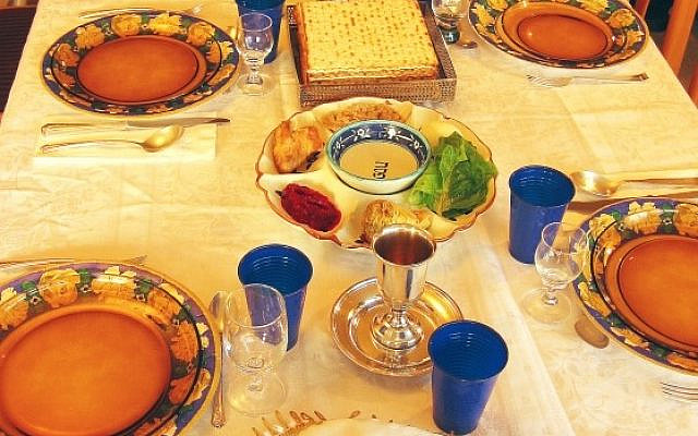 Illustrative. A seder table, including a fifth wine glass, traditionally for Elijah. (iStock)