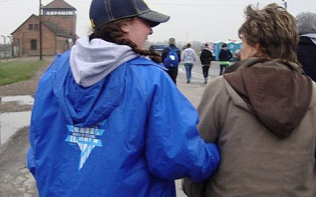 Berkley and Holocaust survivor march arm in arm from Auschwitz to Birkenau, 2010.