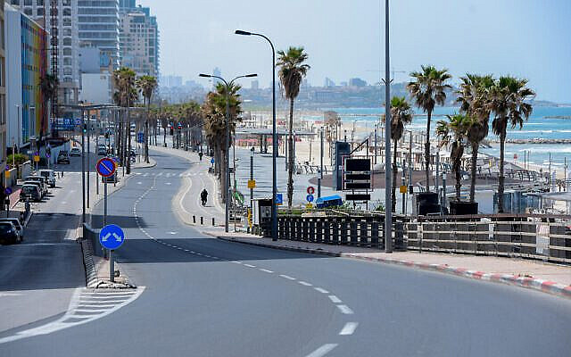 The empty promenade and beach along the shore of the Mediterranean Sea in the Israeli city of Tel Aviv is seen on March 28, 2020. (Avshalom Sassoni/Flash90)