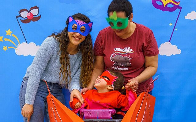 Purim celebrations at Beit Issie Shapiro, where costumes are specially designed to meet children's needs. It is a based on longstanding partnership with design students from the Holon Institute of Technology (HIT). March, 2020. Credit: Jordan Polevoy.