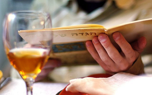 Illustrative. Reading the Haggadah during a solo Passover seder. (iStock)