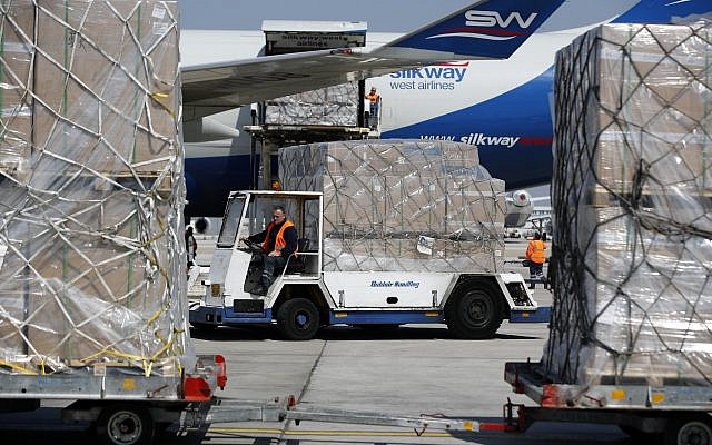 Illustrative. Workers unload a cargo plane at Eleftherios Venizelos International Airport in Athens, March 31, 2020. The cargo plane carrying more than 13 million surgical masks has arrived in Greece, as part of a major shipment of medical supplies from China. (AP Photo/Thanassis Stavrakis)