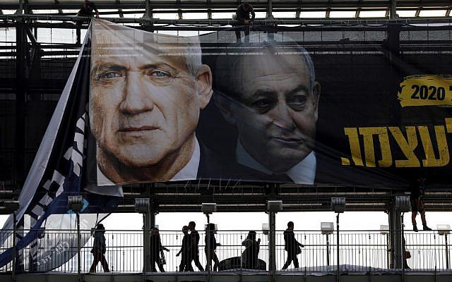 A banner depicting Benny Gantz and Benjamin Netanyahu in Tel Aviv, Israel, February 2020  Ammar Awad / Reuters