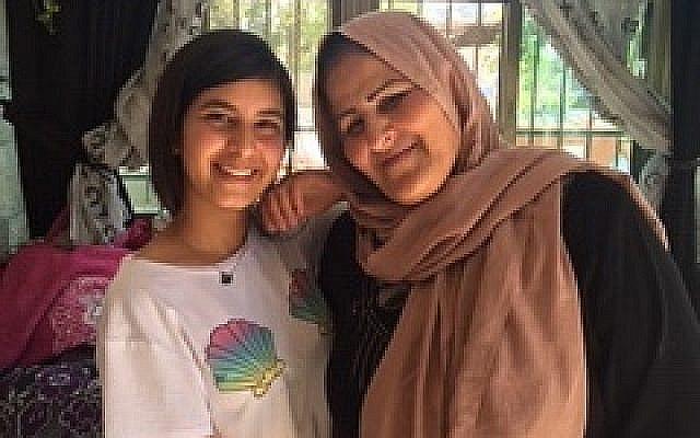 Amal Sumarin and her granddaughter Diana.