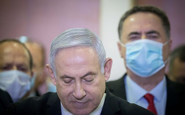 Israeli prime minister Benjamin Netanyahu is surrounded by Likud lawmakers as he gives a press statement ahead of the start of his trial at the District Court in Jerusalem. PM Netanyahu is on trial on criminal allegations of bribery, fraud and breach of trust. May 24, 2020. (Yonatan Sindel/Flash90)