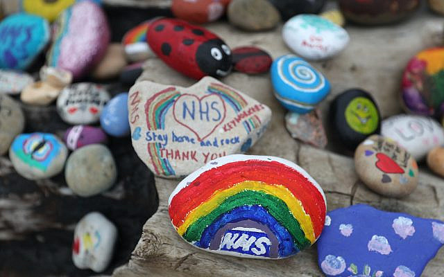 Painted pebbles showing support for the NHS and keyworkers, and containing positive messages, which have been left by members of the public on Avon beach in Christchurch, as the UK continues in lockdown to help curb the spread of the coronavirus. (Jewish News)