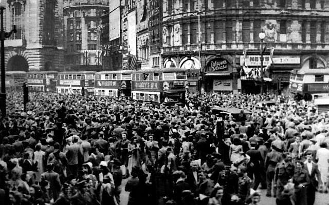 Crowds gathering in celebration at Piccadilly Circus, London during VE Day on May 8, 1945. (Wikipedia)