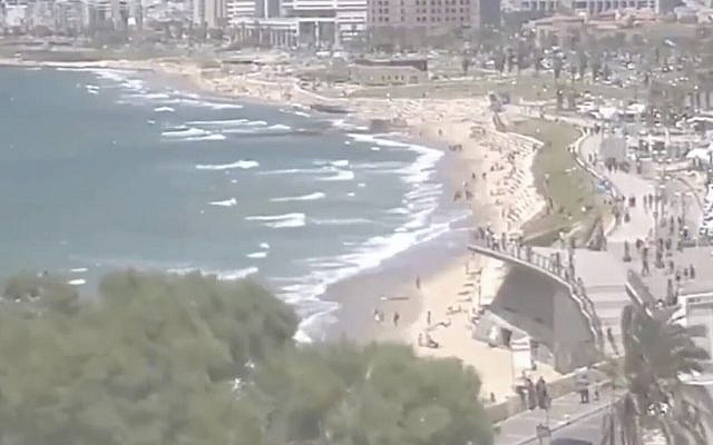Israelis at the beach in Tel Aviv on May 8, 2020. (Screen capture: Twitter)