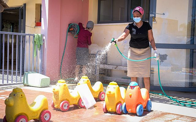 Kindergarten staff clean in the city of Modiin on May 7, 2020. (Yossi Zeliger/ Flash90)