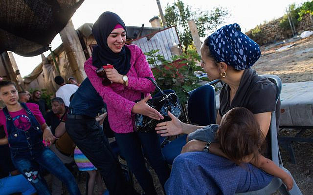 Israeli Jews and Palestinians talk to each other, during a weekly meeting organized by Ali Abu Awwad, a Palestinian from the West Bank, on July 22, 2015. Ali organizes meetings between Jews and Palestinians at his home, to promote cooperation and co-existence. Photo by Nati Shohat/Flash90