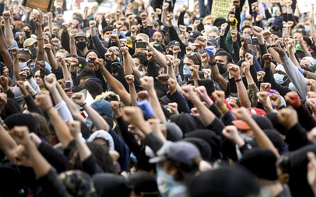 Demonstrators rally in San Francisco, California, on May 31, 2020, protesting the death of George Floyd, who died after being restrained by Minneapolis police officers on May 25, 2020. (AP Photo/Noah Berger)