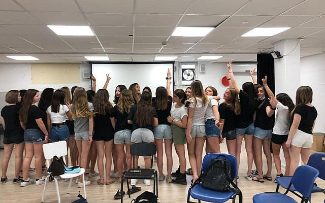 High school girls in Raanana, Israel protest their classmates being sent home for wearing shorts, in violation of the dress code, despite the unusually high summer temperatures. (Facebook)