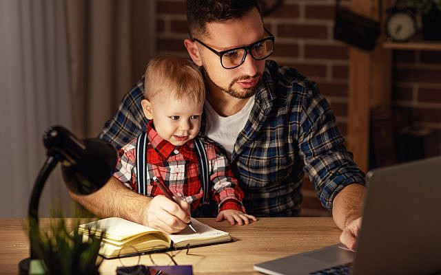 Illustrative. A father trying to pursue higher education from home. (iStock)
