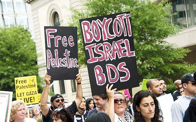 People campaigning to boycott Israel (Jewish News)