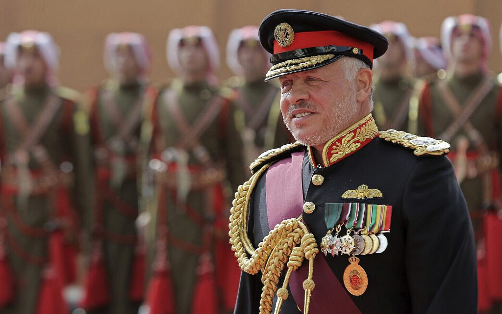 Jordan's King Abdullah II, reviews an honor guard before giving a speech to parliament in Amman, Jordan, November 10, 2019. (AP Photo/Raad Adayleh)