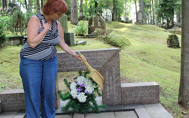 Cleaning mother's and grandmother's gravesite in Vilnius, Lithuania