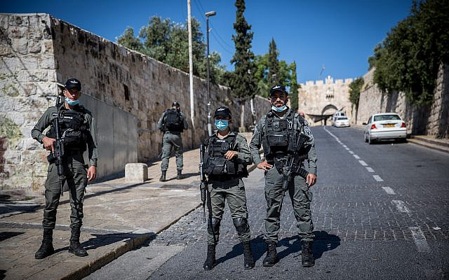 Police guard near the scene where a Palestinian man was shot dead by police earlier in the day at the Lions Gate in Jerusalem Old City on May 30, 2020. (Yonatan Sindel/Flash90)