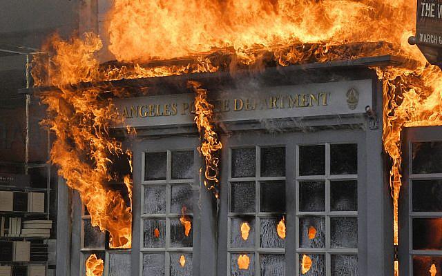 A Los Angeles Police Department kiosk is seen ablaze in The Grove shopping center during a protest over the death of George Floyd, Saturday, May 30, 2020, in Los Angeles. Protests were held in U.S. cities over the death of Floyd, a black man who died after being restrained by Minneapolis police officers on May 25.  (AP Photo/Mark J. Terrill)