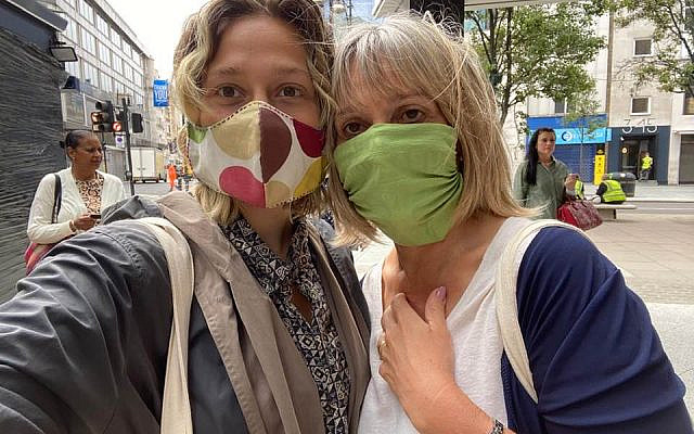 Laura and Sally shopping together - with masks on.