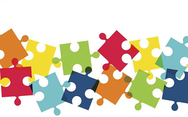 Abstract background with colorful jigsaw puzzle pieces in the lower side