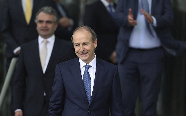 Fianna Fail leader Micheal Martin leaves the Dail - in the Convention Centre, Dublin where he has been elected as the new Irish premier and officially voted in as the new Taoiseach. (Niall Carson/PA Wire)