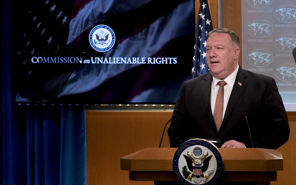 "A monitor displays the words ""Commission on Unalienable Rights"" behind US Secretary of State Mike Pompeo as he speaks during a news conference at the State Department in Washington, Wednesday, July 15, 2020. (AP Photo/Andrew Harnik, Pool)"